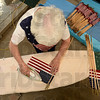 Tribune-Star/Joseph C. Garza<br /> Every flag: Joann Faught uses an iron to press grave marker flags May 18 at her and her husband's home in Sullivan. Faught was pressing the flags since they would be used to mark the graves of veterans at various cemeteries in Sullivan County for Memorial Day.