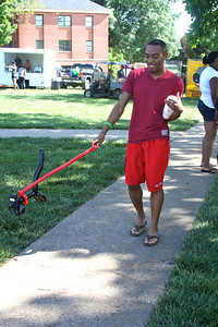 "Jermaine Gash enjoys his ""squirrel on a leash"" during Fridays last blast on the quad."