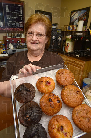 Tribune-Star/Jim Avelis<br /> Goodie shop: Christine Enders shows a tray of muffins in the Brazil Coffee Grounds. She and her daughter-in-law Trina Enders are running the business.