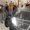 Team: Tribune-Star reporter Sue Loughlin talks with members of the Super Mileage Team Thursday afternoon at the school.