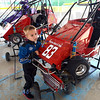 Driver: Six-year-old Carson Dillion waits for his father to prepare him for some laps around the Terre Haute Quarter Midget Track Friday afternoon.