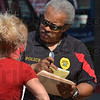 Tribune-Star/Joseph C. Garza<br /> Resident accountability: Terre Haute Police Department Lt. Ed Tompkins checks a list of residents with Garfield Towers Property Manager Melissa Chapman Friday at the facility.