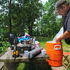 Tribune-Star/Jim Avelis<br /> Gonna be a hot one: Robert Cox prepares a cooler of drink for family and friends that will be spending the memorial Day week end with him at Vigo County's Fowler Park.