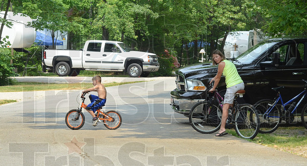 Tribune-Star/Jim Avelis<br /> Get away: Tonya Thompson and her son Shane ride their bikes through the campground at Shakamak State park Friday afternoon. They came up from Princeton to spend the Memorial Day holiday.