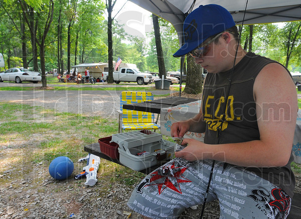 Tribune-Star/Jim Avelis<br /> Down time: David Mundell rigs up a rod and reel for fishing at Fowler Park Friday afternoon. He'll spend the weekend there with family members.