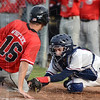 Tribune-Star/Jim Avelis<br /> Not in time: Terre Haute South's Spencer Whitlock beats the throw to home plate, avoiding the tag by Terre Haute North catcher Luke Schoffstall for the game's first run.