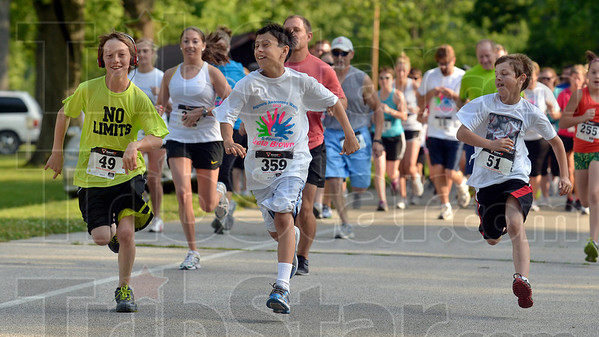 Tribune-Star/Joseph C. Garza<br /> And they're off: Three youngsters bolt from the start line at the beginning of the Wegener's Awareness Warrior 5K Walk/Run Saturday in Brazil.