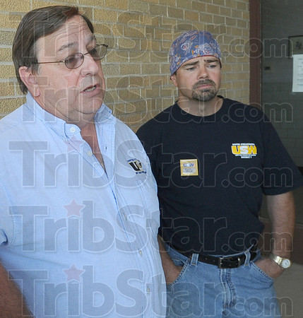Fired: Organizing Coordinator Ted Sautter (L) talks about the recent firing of former Great Dane employee Zach Hyde (R) prior to Saturday's meeting at the Brazil Armory.