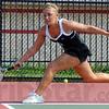 Tribune-Star/Jim Avelis<br /> Too far: Terre Haute South #2 singles player Tabitha Fagg reaches to return a shot by Oldenburg Academy's Sarah Wilder.