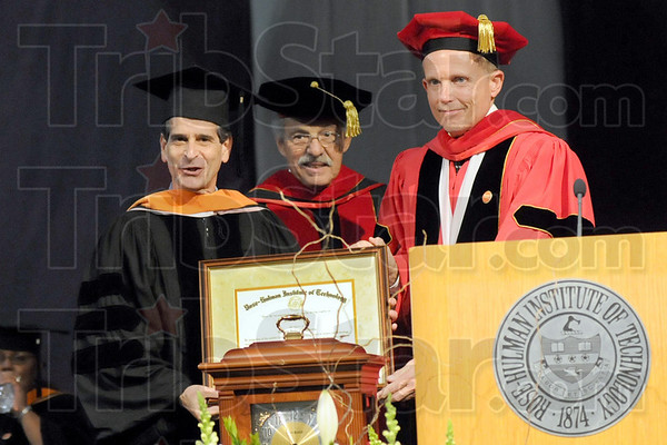 Honorary: Dean Kamen (L) is presented an Honorary Degree by President Robert A. Coons (R) and William Fenoglio during commencement at Rose-Hulman Saturday morning.