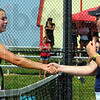 Tribune-Star/Jim Avelis<br /> Congratulations: Maddie Kesler is congratulated on her win by opponent Gretchen Wilder of Oldenburg Academy.