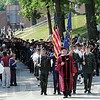 Processional: Marshal and Vice President for Student Affairs and Dean of Students Peter Gustafson leads graduates to the 134th Commencement exercise Saturday morning.