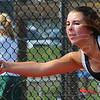 Tribune-Star/Jim Avelis<br /> Within reach: Maddie Kesler returns the ball to her semi-state opponent Gretchen Wilder of Oldenburg Academy in their Saturday match at Center Grove High School.