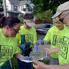 Tribune-Star/Joseph C. Garza<br /> Not done cleaning: Volunteers Cathy Pilant, Carol Waltersdorf, Mary Harris and Bob DeFrance look for another area to cleanup after they finished one section near north 11th Street and Grand Avenue Saturday for Cleanup Terre Haute.