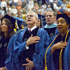 Patriots: Hulman Center patriots stand for the singing of the National Anthem at the start of the 141st Commencement at Indiana State University Saturday afternoon.