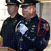 Tribune-Star/Joseph C. Garza<br /> Prayers for the ones who protect us: Terre Haute Police Department Chief John Plasse reads the names of fallen officers during the department's memorial ceremony at police headquarters Thursday.