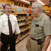 Tribune-Star/Joseph C. Garza<br /> Seasoned grocers: Bob Baesler will be taking over the grocery stores owned by Joe Angell at Angell's Sullivan and Linton locations. Here, Baesler and Angell talk in the Linton Angell's Food Center Wednesday.