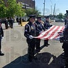 Tribune-Star/Joseph C. Garza<br /> Ceremony: The flag team of the Terre Haute Police Department's Honor Guard ceremoniously folds the flag during the department's memorial ceremony Thursday at police headquarters.