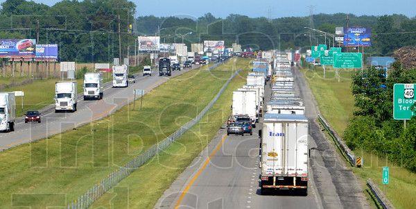 Tribune-Star/Joseph C. Garza<br /> Coming to a standstill: West-bound traffic moves freely along I-70 Wednesday as east-bound motorists come to a standstill after a crash Wednesday east of the Ind. 46 exit.