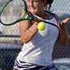 Tribune-Star/Joseph C. Garza<br /> Slugging it out: Terre Haute North's Anna Potter fires a forehand back to opponent Maddie Kesler of South during their No. 1 singles match Wednesday in the South tennis sectional.