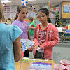 Tribune-Star/Arthur Foulkes<br /> Young consumers: Riley Elementary fourth-graders Cierra Kincade and Ayumi Aikawa buy lemonade from classmate Maddie Kinkade Wednesday at the elementary school.