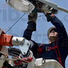 Tribune-Star/Joseph C. Garza<br /> 26 years of experience: Duke Energy Line Specialist Michael Vicars works on a street light at the Wabash Valley Fairgrounds Wednesday as part of the company's Global Service Event.