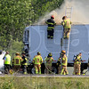 Tribune-Star/Joseph C. Garza<br /> Still burning: Two firefighters stand atop ladders to extinguish a still burning semi trailer after a fatal accident east of Ind. 46 on I-70 Wednesday.