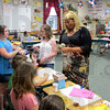 Tribune-Star/Arthur Foulkes<br /> For a good cause: Fourth-grade teacher Sheri Reed collects the funds raised by her students from what they sold Wednesday in her class at Riley Elementary School.