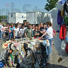 Marlene Cox of Goodwill Industries in Terre Haute shows a bale of bundled plastic to fourth-graders from Meridian Elementary in Brazil during a trip to Goodwill's Terre Haute recycling facility and store. The students recently completed a unit on recycling, and were learning how the items they donate are resold, and the jobs created to do the sorting, recycling and reselling.