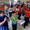 Tribune-Star/Joseph C. Garza<br /> Mustache supporters: John Gregg supporters hold up signs as they applaud a statement made by the gubernatorial candidate Wednesday at the Laborers Local 204.