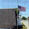 Tribune-Star/Joseph C. Garza<br /> Proper respect: The flag was lowered by the staff of the Moose Lodge in Brazil to honor the late U.S. Army Spc. and Brazil native, Arronn Fields.