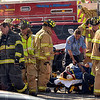 Tribune-Star/Joseph C. Garza<br /> In good hands: Rescue personnel transport one of the victims involved in a wreck at the intersection of Springhill Road and U.S. 41 Tuesday.