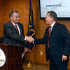 Tribune-Star/Joseph C. Garza<br /> Welcome aboard: Terre Haute Chamber of Commerce Board Chair Norm Lowery shakes hands with the chamber's new President and CEO, Ken Brengle, after Lowery introduced him at  a press conference at the chamber Tuesday.