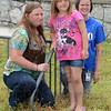 Tribune-Star/Jim Avelis<br /> Grateful: Nicole Pogue poses with her daughter Josie Benefiel and West Vigo Elementary School teacher Holly Meehan by the school's bike rack after school Wednesday.