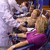 Tribune-Star/Joseph C. Garza<br /> Four chairs, four donors: R. Vernon Mattox, a phlebotomist with the Terre Haute branch of the Indiana Blood Center, chats with Deming Principal Susan Mardis and teacher Susan Cox Monday during a blood drive at the school.