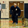 Tribune-Star/Joseph C. Garza<br /> Bite suit bravado: Sarah Scott Middle School librarian/media specialist Tony Smodilla successfully gets one of the Terre Haute Police Department K-9 Unit K-9 officers to attack him during a demonstration of the new suit Monday at the school. Looking on is the unit's Sgt. Terry John.