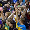 Tribune-Star/Joseph C. Garza<br /> Show of hands: When asked by Terre Haute Police Department K-9 Unit officer Ryan Adamson if they wanted to see their librarian, Tony Smodilla, bit in the unit's bite suit by a K-9 officer, some Sarah Scott Middle School students didn't waste any time to raise their hands Monday during a demonstration at the school.