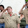 Troop 22: Members of Boy Scout Troop 22 salute during the flag-raising ceremony Monday evening at Ryves Hall.