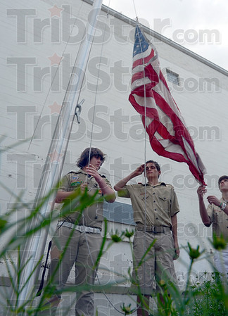 Honor salute:  Honor guard Troop 22 members Johathan Bruce, Steve Trimble and Patrick McCullough raise the flag during Monday's dedication of the flag pole.