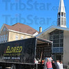 Tribune-Star/Sue Loughlin<br /> Moving: Workers with Eldred Van and Storage move a grand piano out of St. Ann Parish and into a truck, where it will be transported to its  new home at O'Shaughnessy Dining Room, St. Mary-of-the-Woods. The church had its last mass Sunday and has closed, and most of its contents are being moved to other parishes and a seminary.