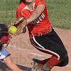 Almost: South second baseman #7 Cheyenne Reinig covers first base as a Plainfield runner slides back just ahead of the tag during game action Wednesday.