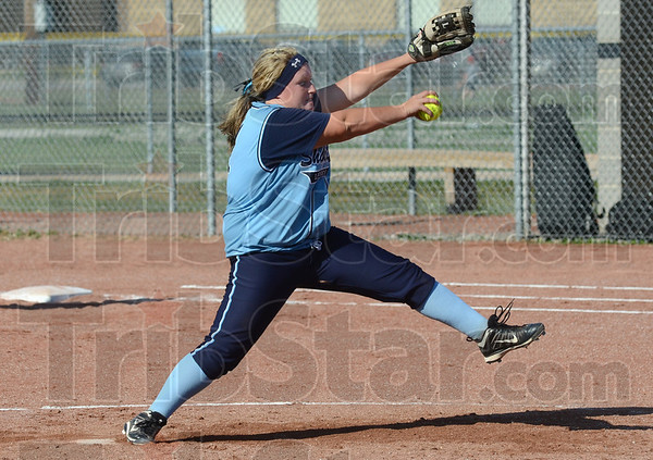 Fire: Shakamak's #21 Kelsey Samm fires a pitch to the plate during early inning action against Bethesda Christian Tuesday evening during Regional play.