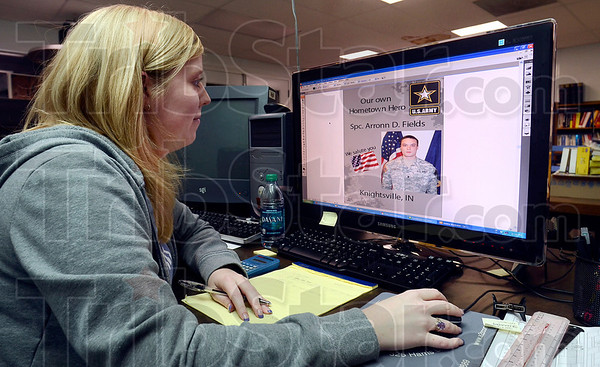 Tribune-Star/Joseph C. Garza<br /> Hometown Hero: National Printing Converters, Inc. graphic designer Ellen Coole finishes the design for an initial printing of the poster for the late U.S. Army Spc. Arronn D. Fields Tuesday at the printing facility in Brazil.