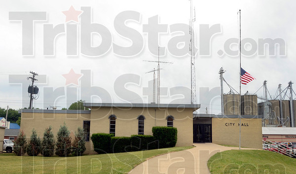 Tribune-Star/Joseph C. Garza<br /> Half staff: The flag in front of the Brazil City Hall rests at half staff Tuesday afternoon for the late U.S. Army Spc. Arronn Fields of Knightsville.