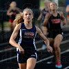 Tribune-Star/Joseph C. Garza<br /> Comfortably in first: Terre Haute North's Jessi Conley maintains the lead across the finish line to take first place in the girls' 400-meter dash Tuesday at South.