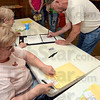 Tribune-Star/Joseph C. Garza<br /> A line in Knightsville: Voter Greg Schopmeyer signs in to vote at the Knightsville Community Center Tuesday.