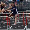 Tribune-Star/Joseph C. Garza<br /> It will take more than a hurdle: Terre Haute North's Keirra Porter clipped the final hurdle in the girls' 100-meter dash but still managed to finish first Tuesday at South.