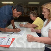 Tribune-Star/Jim Avelis<br /> Sign here: Daniel Woodsmall signs in to vote in the Farmersburg firehouse mid-afternoon Tuesday. Working the polls are clerks Barbara Jewell and Cindy Davis.