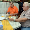 Tribune-Star/Jim Avelis<br /> One by one: Sullivan County absentee ballot board members Bill Raves and Ed Cox count ballots in the clerk's office Tuesday afternoon. They said the numbers appear to be down in comparison to years past.