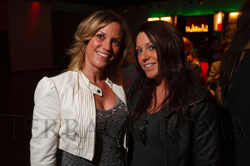 Jennifer Pollard (with Oskar Blues Brewery) and her sister, Lynnette Pollard.  The 2013 Colorado Firefighter Calendar Auditions & Celebrity Judging Event at Exdo Event Center in Denver, Colorado, on Friday, May 11, 2012.<br /> Photo Steve Peterson